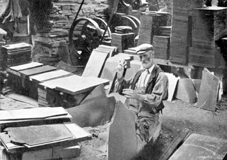 A Quarryman splitting slate