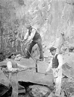 Three rockmen at Dinorwig Quarry splitting a slate block