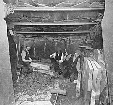 Quarrymen splitting and dressing slate blocks